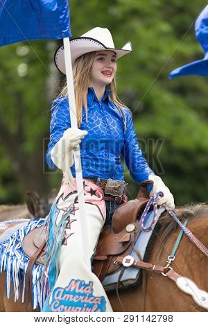 Louisville, Kentucky, Usa - May 03, 2018: The Pegasus Parade, Women Dress Up As Cowgirls Riding Hors