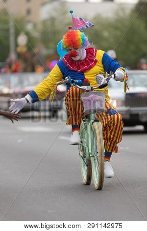 Louisville, Kentucky, Usa - May 03, 2018: The Pegasus Parade, A Clown Riding A Bicycle Down W Broadw