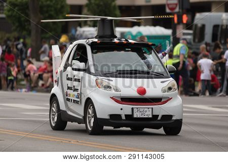 Louisville, Kentucky, Usa - May 03, 2018: The Pegasus Parade, A Compact Car, With A Face Clown And H