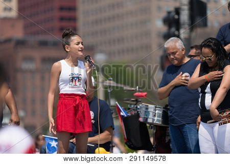 Chicago, Illinois, Usa - June 16, 2018: The Puerto Rican Day Parade, Young Woman Sings The National