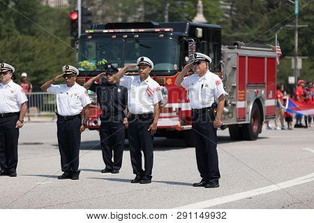 Chicago, Illinois, Usa - June 16, 2018: The Puerto Rican Day Parade, Firefighters Stand Saluting To