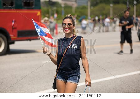 Chicago, Illinois, Usa - June 16, 2018: The Puerto Rican Day Parade, Woman Waving The Puerto Rican F