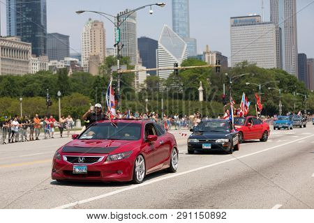 Chicago, Illinois, Usa - June 16, 2018: The Puerto Rican Day Parade, Puerto Ricans Driving A Honda A