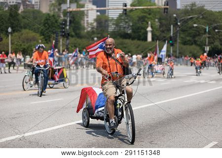 Chicago, Illinois, Usa - June 16, 2018: The Puerto Rican Day Parade, Member Of The Classic Cruisers