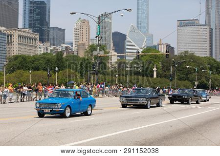 Chicago, Illinois, Usa - June 16, 2018: The Puerto Rican Day Parade, Puerto Rican Driving A Toyota C