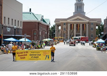 Jasper, Indiana, Usa - August 5, 2018: The Strassenfest Parade, Two Boys Carrying A Banner That Says