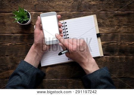Phone Book With A Blank Pages. Mobile Phone With Blank Screen In A Businessman Hands On An Office Ta