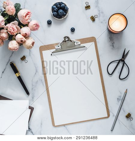 Top View Of Clipboard With White Empty Page. Clipboard, Flowers, Scented Candle On White Marble. Fem