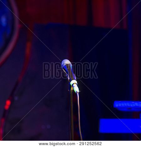 Microphone On A Stage, In A Square Image