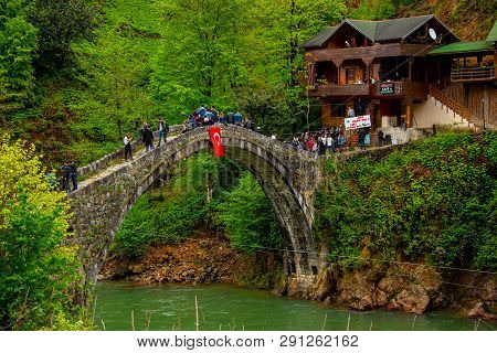 Tourists Visiting The Historical Bridge Above Firtina River Where They Can Enjoy In Zip Line, Turkey