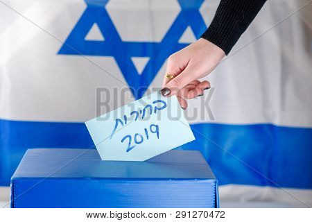 Israeli Woman Votes At A Polling Station On Election Day.close Up Of Hand. Hebrew Text Elections 201