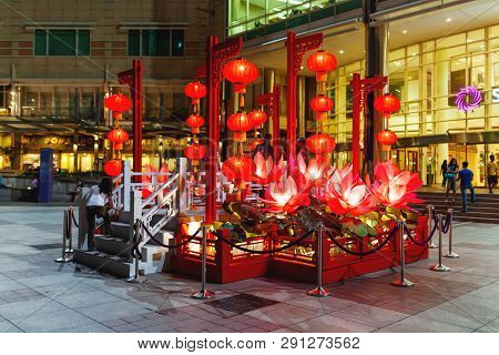 Kuala Lumpur, Malaysia - February 05, 2013. Red Illuminated Decorations In Front Of Petronas Twin To