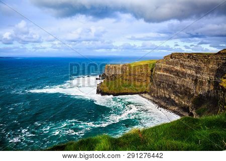 Cliffs Of Moher, Burren, County Clare, Ireland. Sea Cliffs Rise Above Atlantic Ocean. View From Top