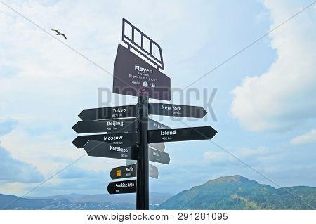 Bergen, Norway - July 21, 2018: Signpost With City Distance On Mount Floyen In Bergen