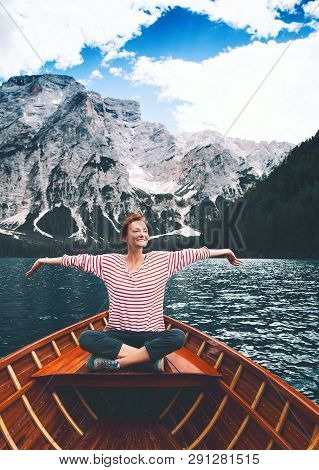 Tourist Woman In Traditional Wooden Rowing Boat On Italian Alpine Braies Lake. Girl Enjoying Stunnin