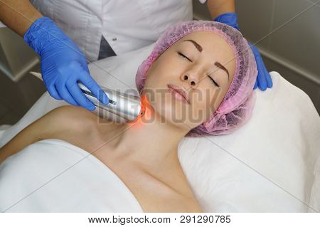 Ultrasound chromotherapy. Hardware cosmetology. Beautician carries out procedure for tightening skin of face. Spa. Non-surgical cosmetology. Skin peeling poster