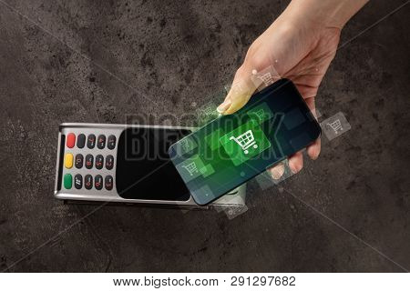 Easy paying with mobile phone in the market