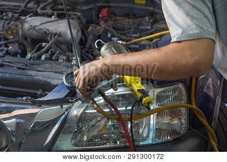 Auto Mechanic Fixing Air Condition In Garage . Monitoring Tools Check Car Air Conditioner System.