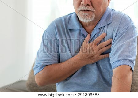 Senior Male Asian Suffering From Bad Pain In His Chest Heart Attack At Home - Senior Elderly People