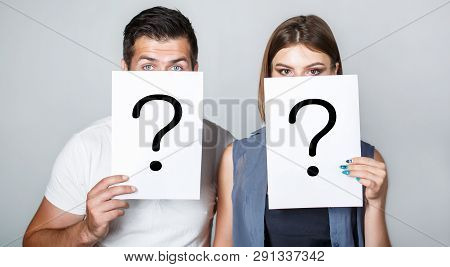 Anonymous, Man And Woman Question. Problems And Solutions. Getting Answers. Portrait Of Couple Holdi