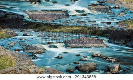Amazing Turquoise Water Stream With Stones And Mirror Horizon Effect, Time Lapse. Beautiful Fast Blu