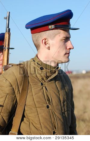 KIEV,UKRAINE - NOV 9: Person in Soviet WW2 military uniform of NKVD (KGB) Member of military history club Red Star. Historical military reenacting Kiev ,Ukraine. 7-9 November 2008