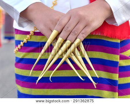 Close Up Image Of Northern Thailand Woman Dress Her Fingers With Golden Metal As Fingernails Like A