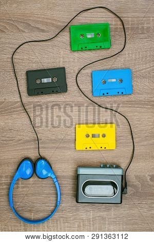 Vintage Cassette Player, Colorful Cassete And Headphones On The Wooden Background