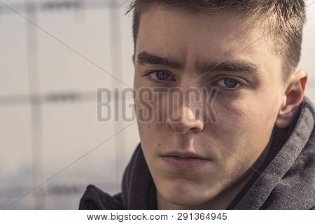 Close Up Portrait Of A Young Serious Man