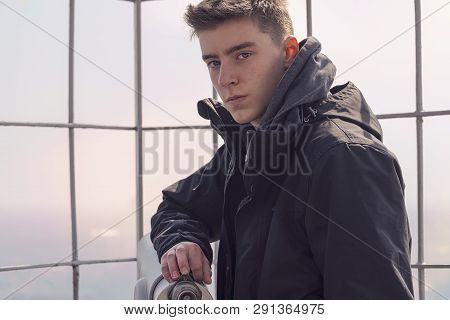 Portrait Of A Young Man Leaning On A Tower Viewer