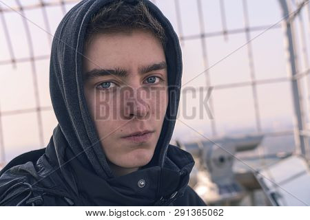 Portrait Of A Serious Young Man With Hoodie