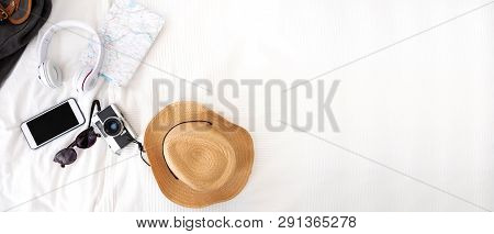 Summer Travel Items On Blanket On Bed.top View Of Accessories Travel (camera,hat,headphone,map ) On