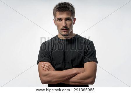 Portrait Of A Young Man With Crossed Arms, Isolated On White