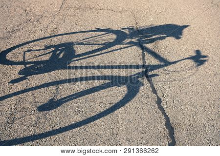 Shadow Of A Bicycle On The Street
