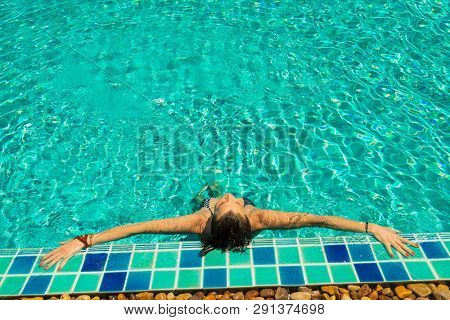 woman in luxury five stars  spa resort in the swimming pool. - No body retouching poster