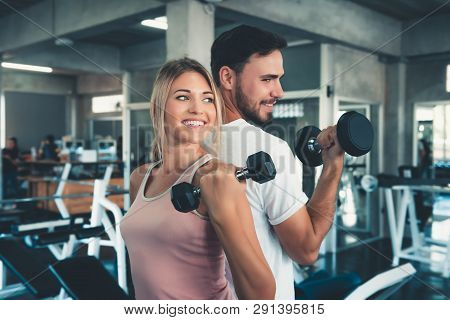 Portrait Of Couple Love In Fitness Training With Dumbbell Equipment., Young Couple Caucasian Are Wor