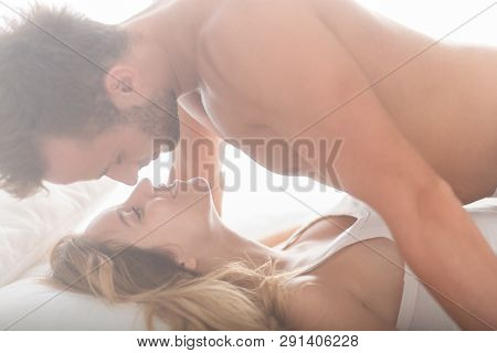 Handsome Man And Beautiful Woman Gazing Into Each Others Eyes During Sex