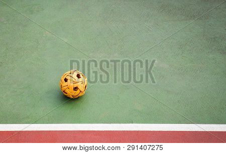 Sepak Takraw Ball Or Rattan Ball On Field Of Sepak Takraw Court With Line On Sport Outdoors