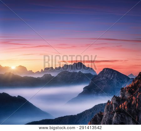 Mountains In Fog At Beautiful Sunset In Autumn In Dolomites, Italy. Landscape With Alpine Mountain V