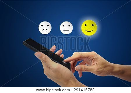 Conceptual The Customer Responded To The Survey. The Client Using Hand Choose Happy Face Smile Icon