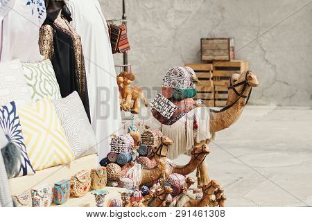 Uae, Dubai - January, 2019: Traditional Arab Market With Gifts And Souvenirs At Al Seef Area. Camels