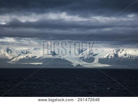 Glaciers Under A Leaden Sky Moving To The Sea
