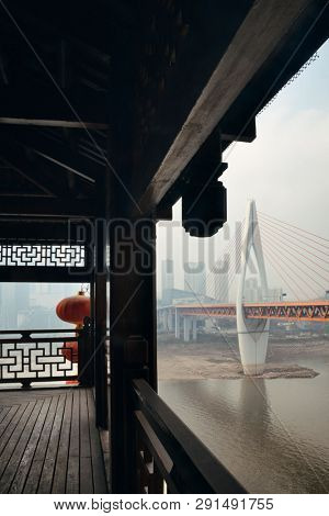 Hongyadong complex with bridge and city urban architecture in Chongqing, China.