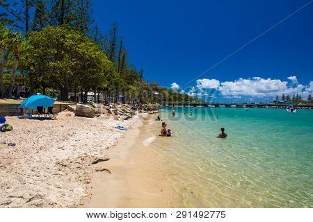 Gold Coast, AUS - JAN 12 2019: People enjoying beach activities at famous family beach at Tallebudgera Creek  Gold Coast, Queensland, Australia