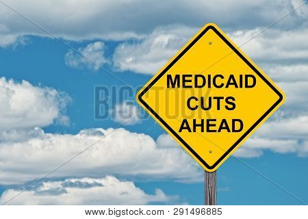 Medicaid Cuts Ahead Caution Sign With Blue Sky Background
