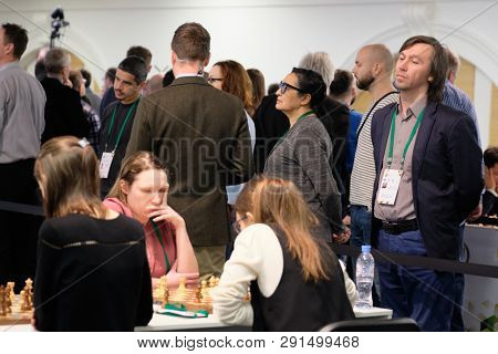 ST. PETERSBURG, RUSSIA - DECEMBER 28, 2018: Grandmaster Gata Kamsky, USA (right) watches women compete in the final round of King Salman World Rapid Chess Championship 2018