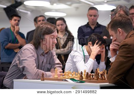 ST. PETERSBURG, RUSSIA - DECEMBER 28, 2018: Grandmaster Gata Kamsky, USA (left) competes in King Salman World Rapid Chess Championship 2018. Eventually he took 22nd place