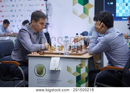 ST. PETERSBURG, RUSSIA - DECEMBER 27, 2018: Match Dmitry Andreikin, Russia (left) vs Yu Yangyi, China during King Salman World Rapid Chess Championship 2018. The match ended with a draw