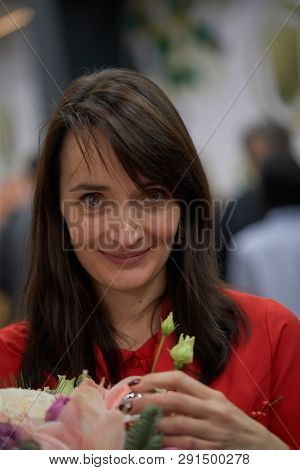 ST. PETERSBURG, RUSSIA - DECEMBER 27, 2018: Grandmaster Kateryna Lagno, Russia with flowers due to her birthday during King Salman World Rapid Chess Championship 2018. Eventually she took 7th place