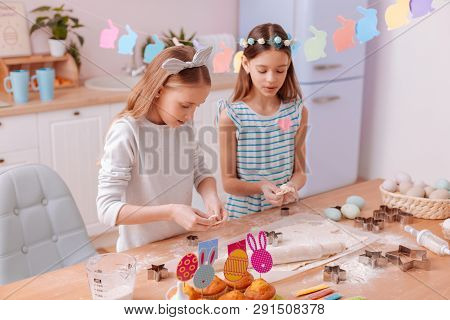 Positive Delighted Children Preparing Cookies For Easter